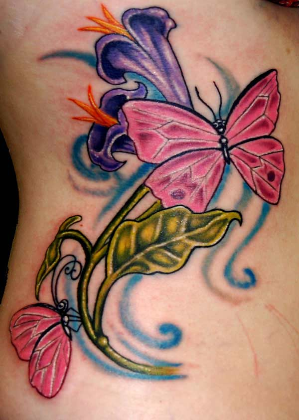 Lovely-Tulip-Flowers-And-Butterflies-Tattoos-On-Rib-1