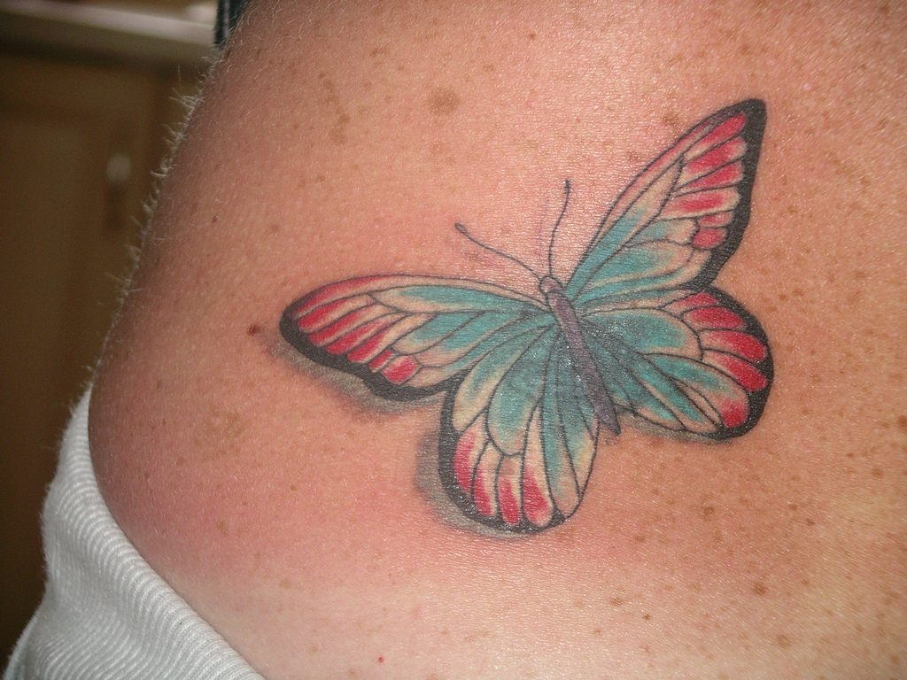 Small-Lower-Back-Butterfly-Tattoo-Design-for-Girls