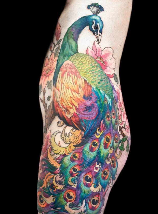 This-amazing-peacock-tattoo-across-the-hip-and-leg-can-be-hidden-under-clothing-and-revealed-only-to-an-intimate-loved-one